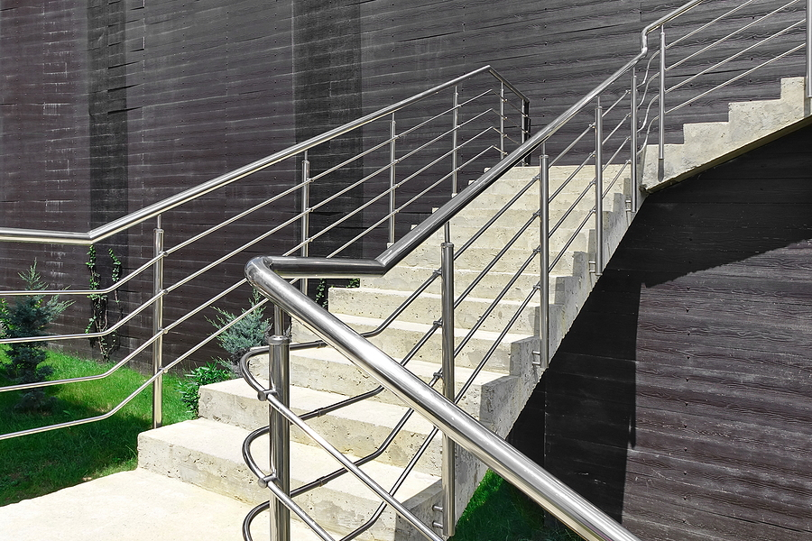 outdoor cement staircase with railings