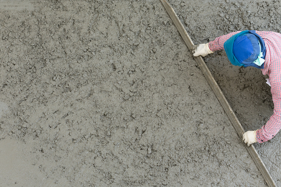 worker scraping the cement